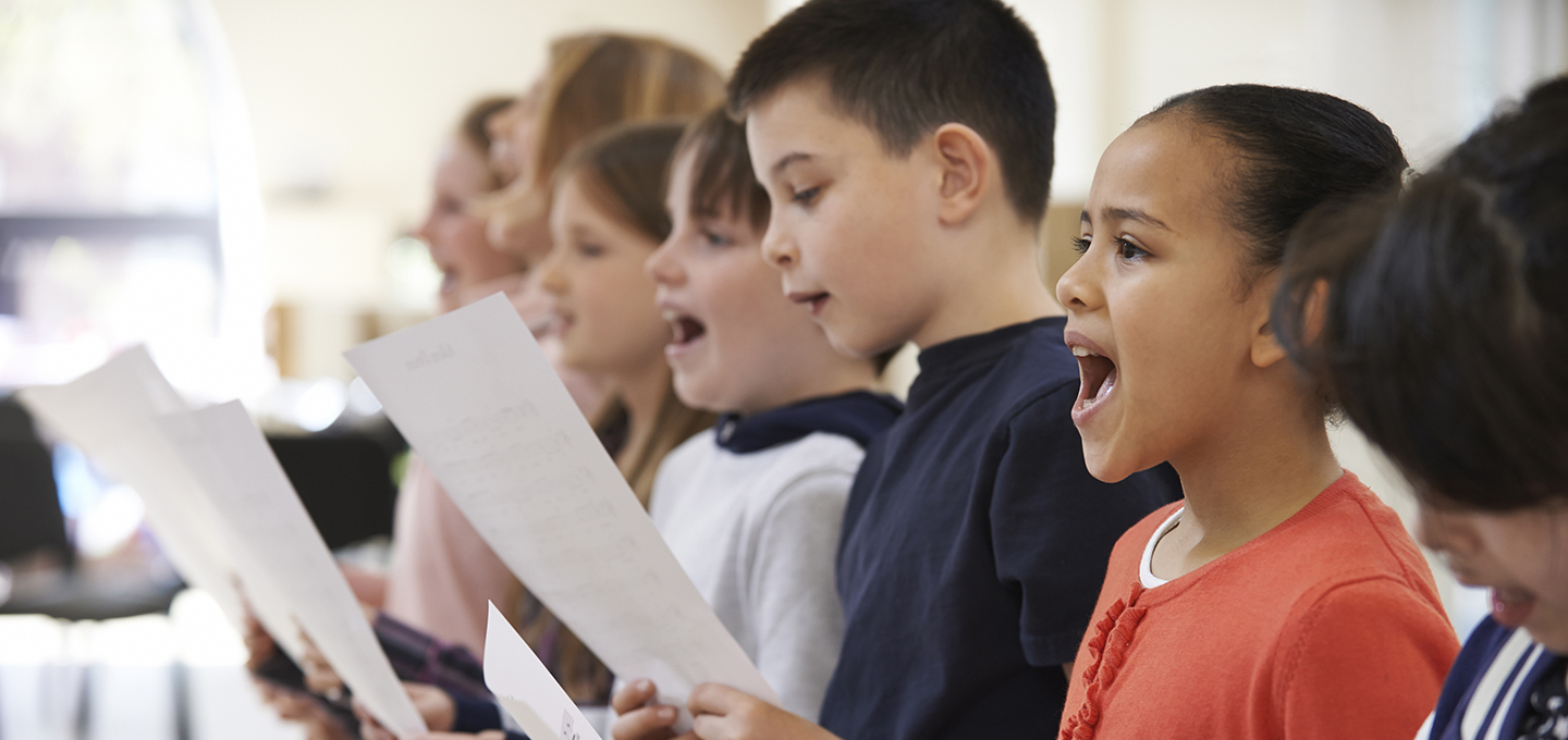 children singing with music