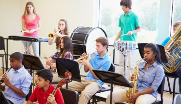 Children playing in school band